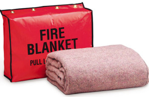 "Treated with Dupont X-12 for fire retardancy. This 62""x80"" blanket is fire retardant in accordance with the Federal Flammable Fabrics Act, CS 191-53. Machine washable, comes with 4 mounting brass grommet holes. THE LABEL READS: ""70% Wool, 30% Synthetic, Fire Retardant"""