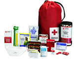 Image of an American Red Cross Emergency Disaster Supplies kit with contents spread out to show all thetypes of food, water, emergency shelter and signaling required in an earthquake or other disaster.